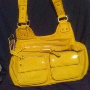 Tyler Rodan mustard color purse with umbrella
